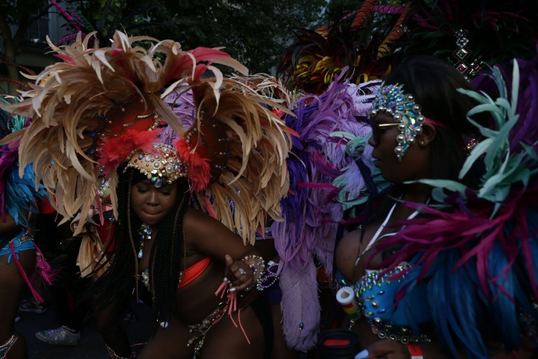 Performers dance on the second day of the Notting Hill Carnival in west London on August 29, 2016. Nearly one million people are expected by the organizers Sunday and Monday in the streets of west London's Notting Hill to celebrate Caribbean culture at a carnival considered the largest street demonstration in Europe. (Daniel Leal-Olivas/AFP/Getty Images)