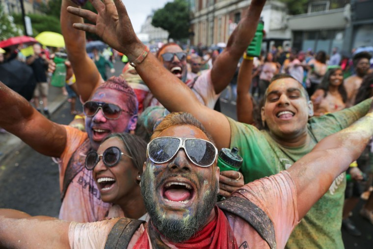 Revellers pose on the first day of the Notting Hill Carnival in west London on August 28, 2016. Nearly one million people are expected by the organizers Sunday and Monday in the streets of west London's Notting Hill to celebrate Caribbean culture at a carnival considered the largest street demonstration in Europe. (Daniel Leal-Olivas/AFP/Getty Images)
