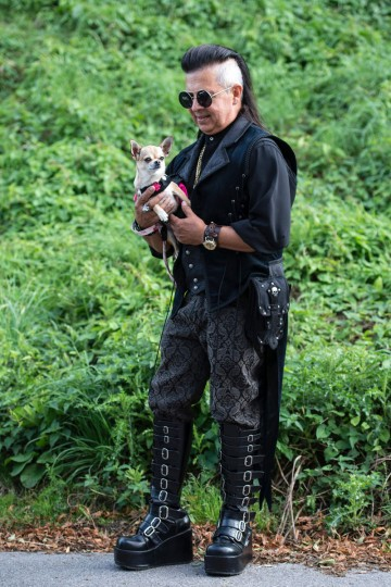 A Steampunk enthusiast Dante Prince holds his 2 year-old chihuahua 'Peyton' as they attend the first day of 'The Asylum Steampunk Festival' in Lincoln, northern England on August 26, 2016. The four-day alternative lifestyle festival is the largest and longest running steampunk festival in the World; combining art, literature, music, fashion and comedy. Steampunk is a subgenre of science fiction or science fantasy that incorporates technology and aesthetic designs inspired by 19th-century industrial steam-powered machinery. / (AFP Photo/Oli Scarff)