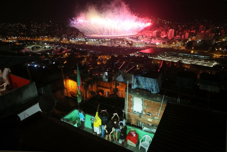 RIO DE JANEIRO, BRAZIL - AUGUST 05: Fireworks explode over Maracana stadium with the Mangueira 'favela' community in the foreground during opening ceremonies for the Rio 2016 Olympic Games on August 5, 2016 in Rio de Janeiro, Brazil. The Rio 2016 Olympic Games commenced tonight at the iconic stadium. (Photo by Mario Tama/Getty Images)