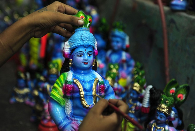 A Indian women worker gives finishing touches to a idol of Hindu god Krishna at a workshop on occasion of 'Krishna Janmashtami' in Chennai on August 20,2016. Brithday of Indian Hindu God Krishna is celebrated as'Krishna Janmashtami' by hindus all over world on 25th of August. (Arun Sankar/AFP/Getty Images)