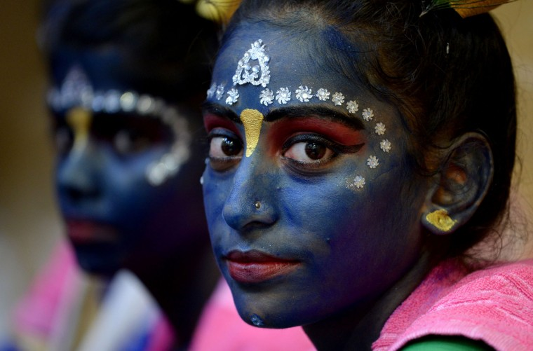 Indian participants dressed as the Hindu god Lord Krishna wait for the start of a cultural event in the run up to the dahi handi (curd pot) celebrations of 'Janmashtami', which mark the birth of Lord Krishna, in Mumbai on August 23, 2016. India's top court on August 17, 2016, has banned children from taking part in a popular but potentially dangerous religious festival in the country's west that sees young boys scale human pyramids. The Supreme Court barred children aged under 18 from scaling the pyramids and restricted their height to 20 feet (six metres) following a string of accidents in recent years. (Indranil Mukherjee/AFP/Getty Images)