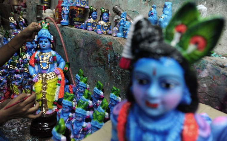 An Indian worker gives the finishing touches to an idol of Hindu god Krishna at a workshop in Chennai on August 20, 2016. The birthday of Indian Hindu God Krishna will be celebrated as 'Krishna Janmashtami' by Hindus all over world on August 25. (Arun Sankar/AFP/Getty Images)