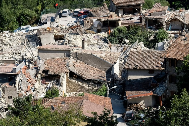 Partial view of Pescara del Tronto, a central Italian village near Amatrice, taken on August 26, 2016, two day after a 6.2-magnitude earthquake struck the region killing some 267 people. An increasingly forlorn search for victims of the earthquake that brought carnage to central Italy entered a third day on August 26, 2016 as a day of mourning was declared for victims of a disaster that has claimed at least 267 lives. Releasing the new confirmed death toll, Immacolata Postiglione, head of the Civil Protection agency's emergency unit, indicated there had been no survivors found overnight in any of the remote mountain villages devastated by August 24's powerful pre-dawn quake. At least 367 people have been hospitalised with injuries but no one has been pulled alive from the piles of collapsed masonry since August 24 evening. (Mario Laporta/AFP/Getty Images)