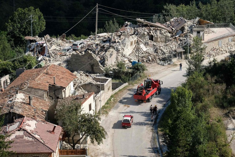 View of damages in a street of Pescara del Tronto, a central Italian village near Amatrice, on August 26, 2016, two day after a 6.2-magnitude earthquake struck the region killing some 267 people. An increasingly forlorn search for victims of the earthquake that brought carnage to central Italy entered a third day on August 26, 2016 as a day of mourning was declared for victims of a disaster that has claimed at least 267 lives. Releasing the new confirmed death toll, Immacolata Postiglione, head of the Civil Protection agency's emergency unit, indicated there had been no survivors found overnight in any of the remote mountain villages devastated by August 24's powerful pre-dawn quake. At least 367 people have been hospitalised with injuries but no one has been pulled alive from the piles of collapsed masonry since August 24 evening. (Mario Laporta/AFP/Getty Images)