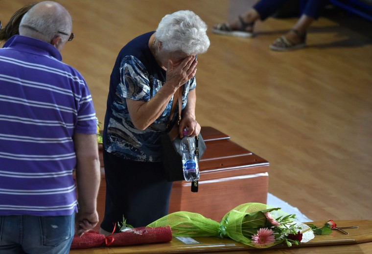 A woman mourns next to the coffin of an earthquake victim, in a gymnasium arranged in a chapel of rest on August 26, 2016, in Ascoli Piceno, two day after a 6.2-magnitude earthquake struck the region killing some 267 people. Italy on August 26, 2016 declared a day of mourning for victims of a devastating earthquake as hopes of finding any more survivors dwindled and the confirmed death toll rose to 267. Flags will fly at half-mast across the country on August 27 to coincide with funerals for some of the victims. Immacolata Postiglione, head of the Civil Protection agency's emergency unit, said no new survivors had been found overnight in the remote mountain villages blitzed by the powerful pre-dawn quake on August 24, 2016. (Alberto Pizzoli/AFP/Getty Images)