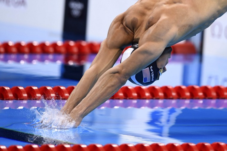 USA's Michael Phelps competes in the Men's 200m Individual Medley Semifinal during the swimming event at the Rio 2016 Olympic Games at the Olympic Aquatics Stadium in Rio de Janeiro on August 10, 2016. (Christophe Simon/AFP/Getty Images)