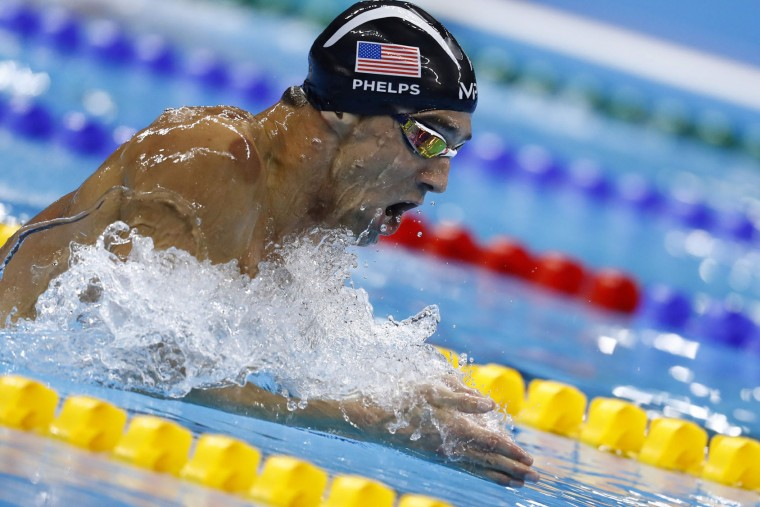 USA's Michael Phelps competes in the Men's 200m Individual Medley Semifinal during the swimming event at the Rio 2016 Olympic Games at the Olympic Aquatics Stadium in Rio de Janeiro on August 10, 2016. (Odd Andersen/AFP/Getty Images)