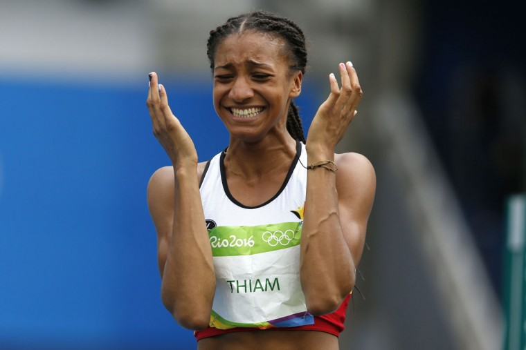 Belgium's Nafissatou Thiam reacts in the Women's Heptathlon High Jump during the athletics event at the Rio 2016 Olympic Games at the Olympic Stadium in Rio de Janeiro on August 12, 2016. / (AFP Photo/Adrian Dennis)