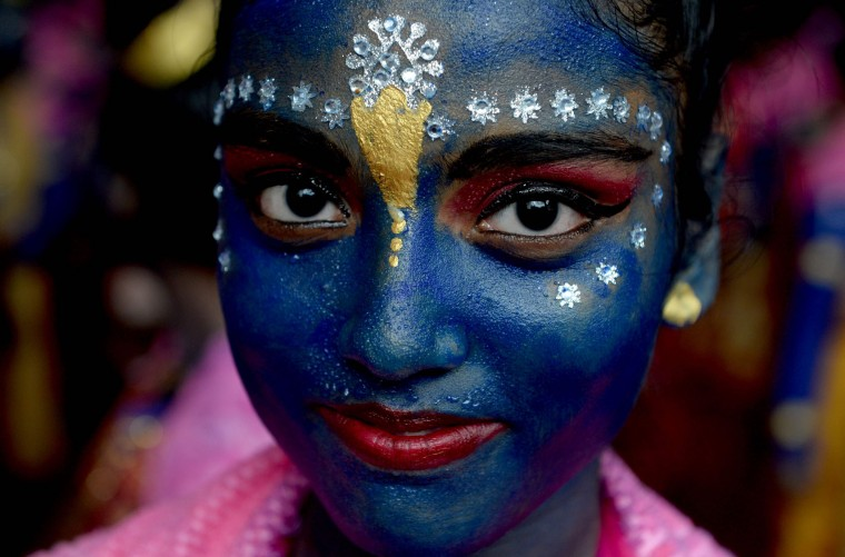 An Indian participant dressed as the Hindu god Lord Krishna looks on during a cultural event in the run up to the dahi handi (curd pot) celebrations of 'Janmashtami', which mark the birth of Lord Krishna, in Mumbai on August 23, 2016. India's top court on August 17, 2016, has banned children from taking part in a popular but potentially dangerous religious festival in the country's west that sees young boys scale human pyramids. The Supreme Court barred children aged under 18 from scaling the pyramids and restricted their height to 20 feet (six metres) following a string of accidents in recent years. (Indranil Mukherjee/AFP/Getty Images)