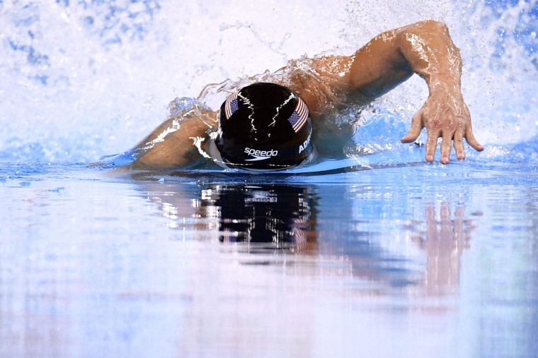 USA's Nathan Adrian competes in the Men's 100m Freestyle Final during the swimming event at the Rio 2016 Olympic Games at the Olympic Aquatics Stadium in Rio de Janeiro on August 10, 2016. (Martin Bureau/AFP/Getty Images)