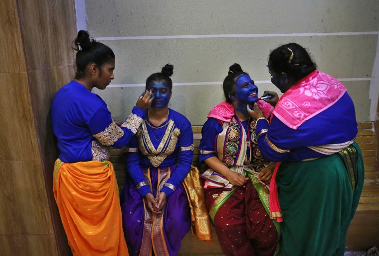 Indian students get their faces painted in blue color as they prepare for Janmashtami celebrations at a college in Mumbai, India, Tuesday, Aug. 23, 2016. Janmashtami, is an annual celebration of the birth of the Hindu deity Krishna. (AP Photo/Rafiq Maqbool)