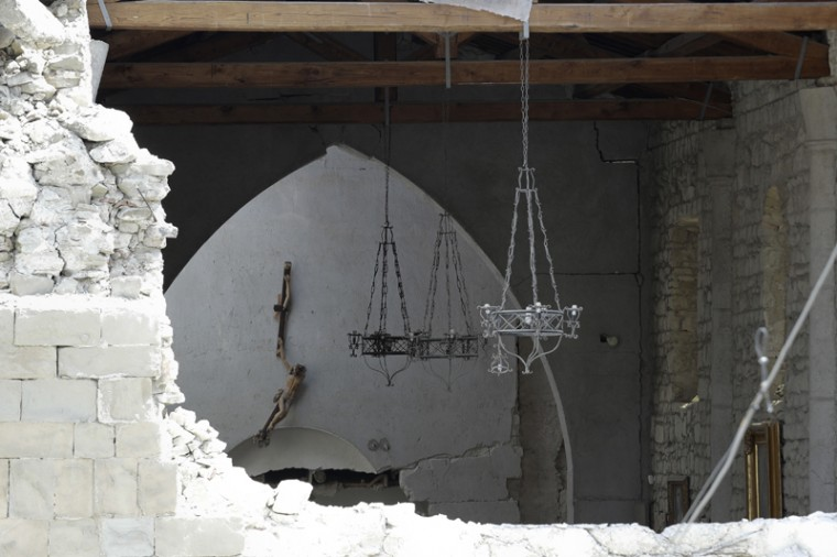 A broken crucifix hangs from a wall of the church of Accumoli, central Italy, following an earthquake Wednesday. The magnitude 6 quake struck at 3:36 a.m. and was felt across a broad swath of central Italy, including Rome, where residents of the capital felt a long swaying followed by aftershocks. (Andrew Medichini/AP)