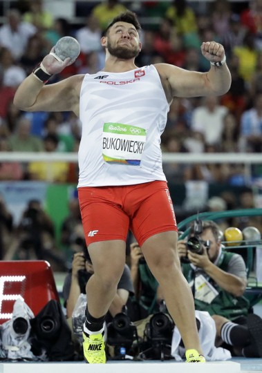 Poland's Konrad Bukowiecki makes an attempt in the men's shot put final during the athletics competitions of the 2016 Summer Olympics at the Olympic stadium in Rio de Janeiro, Brazil, Thursday, Aug. 18, 2016. (AP Photo/Matt Dunham)