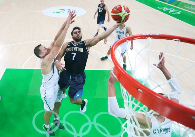 Argentina's Facundo Campazzo (7) drives to the basket past Lithuania's Marius Grigonis, left, during a basket ball game at the 2016 Summer Olympics in Rio de Janeiro, Brazil, Thursday, Aug. 11, 2016. (Tom Pennington/Pool Photo via AP)