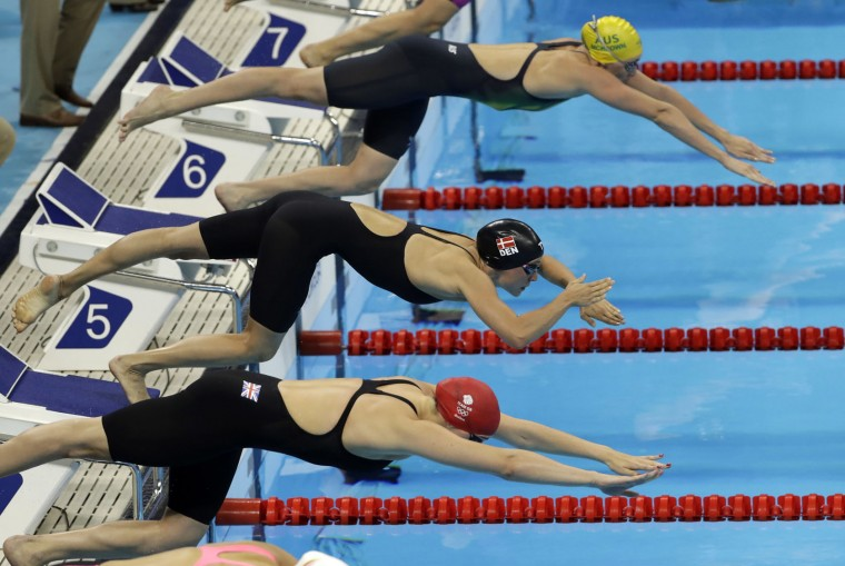 Denmark's Rikke Moller Pedersen, center, competes in a semifinal of the women's 200-meter breaststroke during the swimming competitions at the 2016 Summer Olympics, Wednesday, Aug. 10, 2016, in Rio de Janeiro, Brazil. (AP Photo/Matt Slocum)