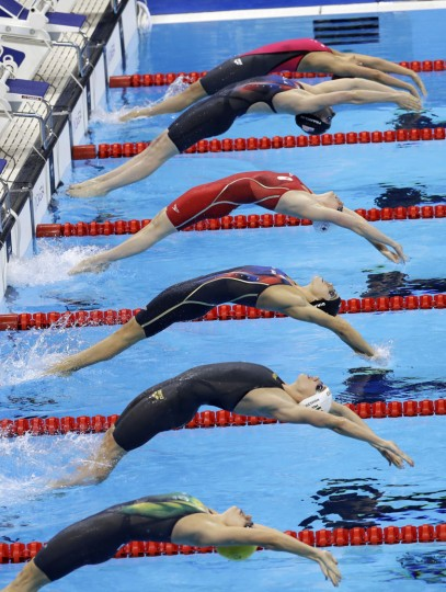 Competitors take part in a semifinal of the women's 200-meter backstroke during the swimming competitions at the 2016 Summer Olympics, Thursday, Aug. 11, 2016, in Rio de Janeiro, Brazil. (AP Photo/Natacha Pisarenko)