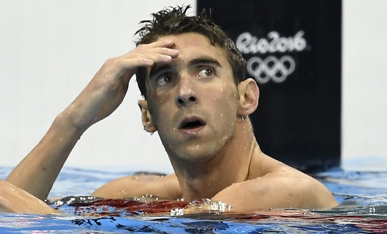 United States' Michael Phelps checks his time after competing in a men's 200-meter individual medley semifinal during the swimming competitions at the 2016 Summer Olympics, Wednesday, Aug. 10, 2016, in Rio de Janeiro, Brazil. (AP Photo/Martin Meissner)