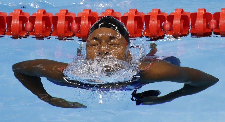 United States' Simone Manuel leaves the pool after winning the gold and setting a new Olympic record in the women's 100-meter freestyle during the swimming competitions at the 2016 Summer Olympics, Thursday, Aug. 11, 2016, in Rio de Janeiro, Brazil. (AP Photo/Natacha Pisarenko)