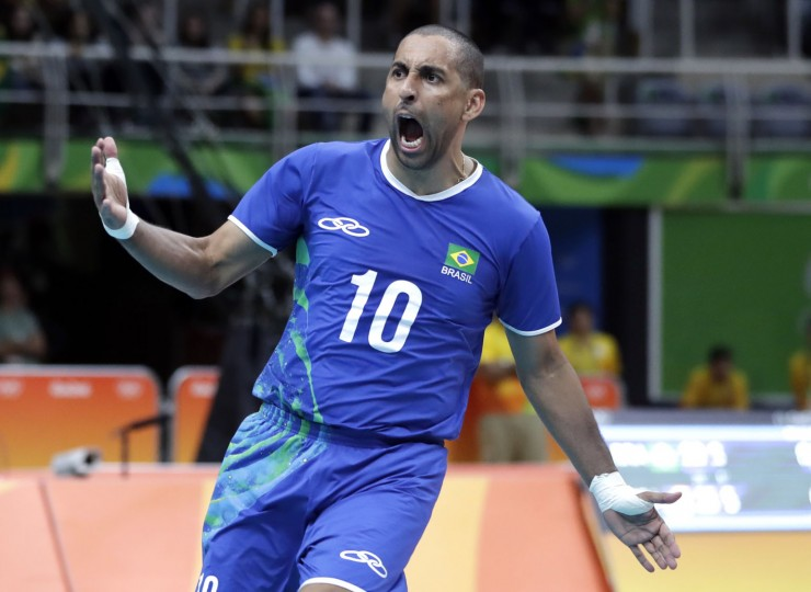 Brazil's Sergio Dutra Santos celebrates during a men's preliminary volleyball match against the United States at the 2016 Summer Olympics in Rio de Janeiro, Brazil, Thursday, Aug. 11, 2016. (AP Photo/Jeff Roberson)