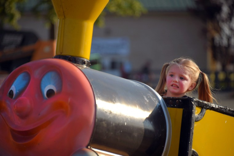 Teagan Horseman, 4, doesn't like Miner Mike, her first roller coaster ride, during the annual Harford County Farm Fair. (Karl Merton Ferron / Baltimore Sun)