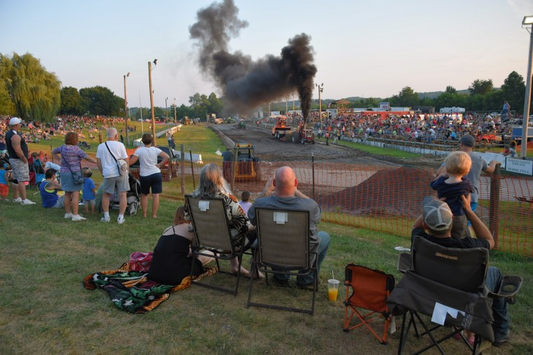 Spectators watch the Lucas Oil Truck and Tractor Pull during the annual Harford County Farm Fair. (Karl Merton Ferron / Baltimore Sun)