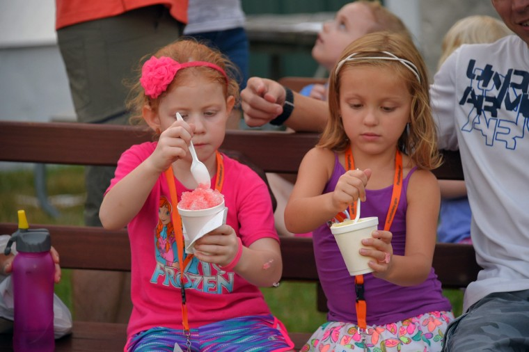 Ava Moffett, 6 of Bel Air (left) and neighbor/friend Morgan Rowe, 6, both knock down their snowballs during the annual Harford County Farm Fair. (Karl Merton Ferron / Baltimore Sun)