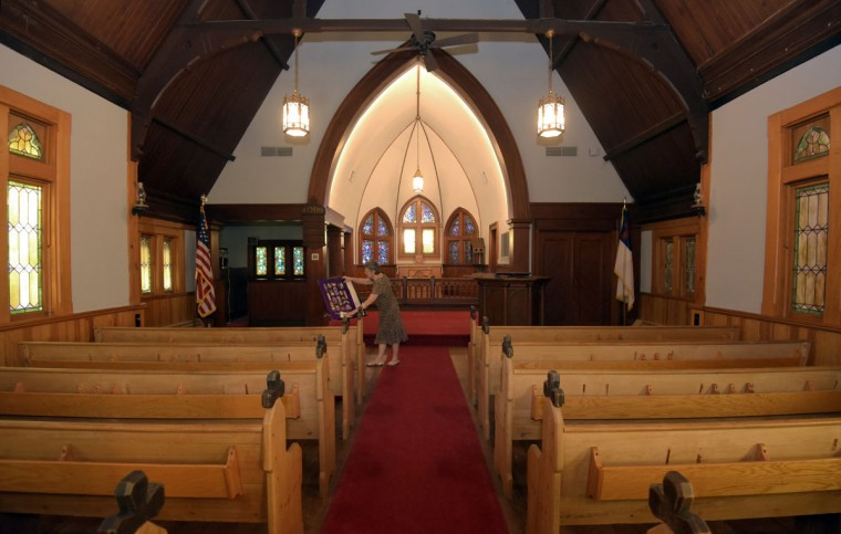 "Nancy Cook, chair of the Historic Stevensville Arts & Entertainment District, and chair of the Historic Sites consortium of Queen Anne's County, is pictured inside Christ Church and Rectory built in 1880 in Stevensville. According to the Kent Island Heritage Society, Inc., it is ""the fifth church of this Christ Church parish founded in 1631, and is the oldest continuous Episcopal congregation in the United States."" Along with other historical sites in Stevensville, the church is open the first Saturdays of the month from May to October. (Algerina Perna/Baltimore Sun)"