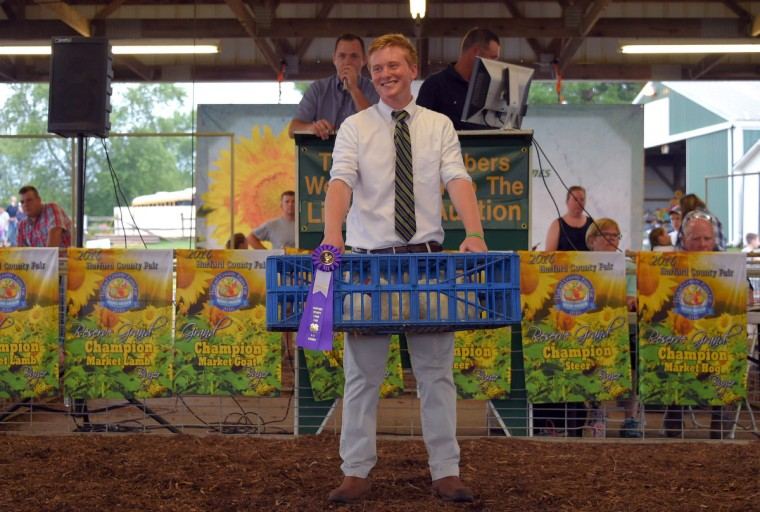 Noah Sekowski, 16 of Forest Hill holds 10-week-old cornish pair that won grand champion prize, which is sold at auction for $550 during the annual Harford County Farm Fair. (Karl Merton Ferron / Baltimore Sun)