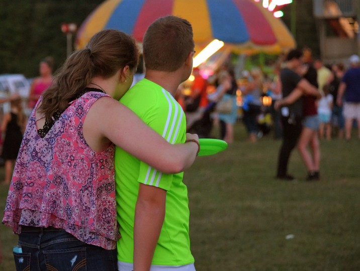A young couple press together during the annual Harford County Farm Fair. (Karl Merton Ferron / Baltimore Sun)