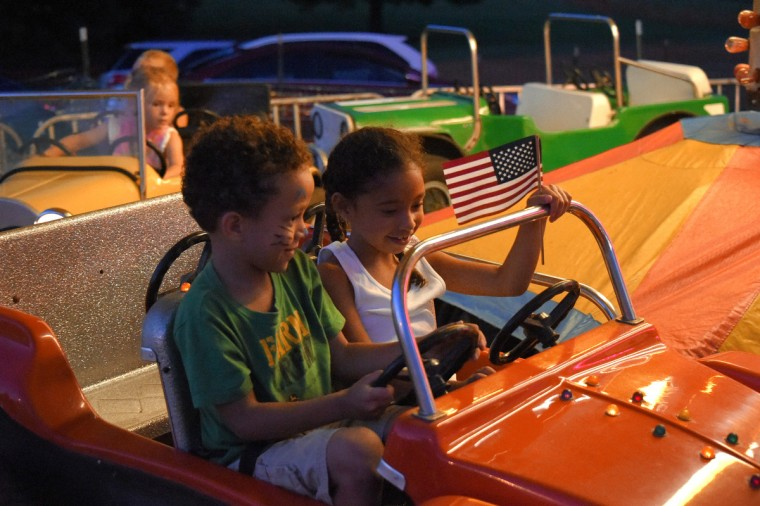 Siblings Jayden, 4 of Bel Air and Alicia Bond, 7 of Street enjoy a kiddie ride during the annual Harford County Farm Fair. (Karl Merton Ferron / Baltimore Sun)