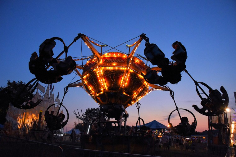 The Tornado ride glows in the twilight during the annual Harford County Farm Fair. (Karl Merton Ferron / Baltimore Sun)