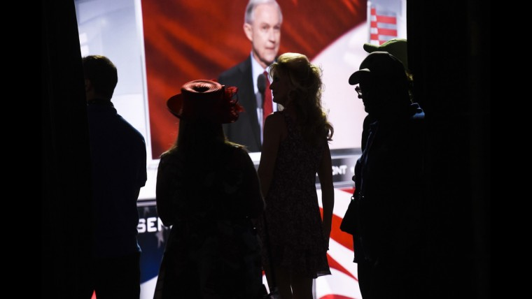 Convention-goers listen to Arkansan Governor Asa Hutchinson on June 19 at the Republican National Convention.
