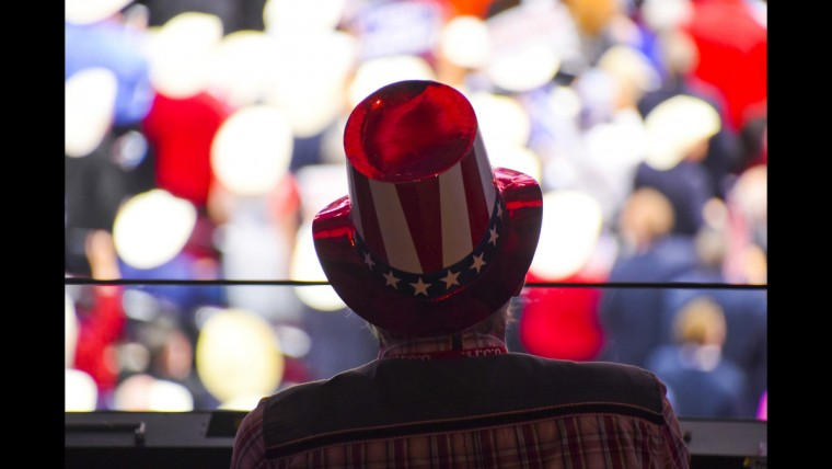 A Trump supporter watches the final night of the Republican National Convention in Cleveland on June 21.