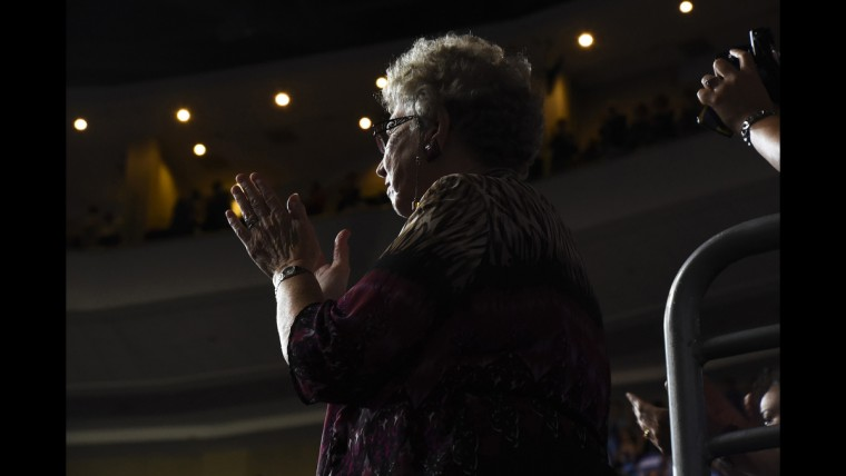 A woman gives a standing ovation following Vice President's Joe Biden's speech at the Democratic National Convention on June 27.