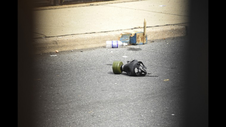 A gas mask is left behind the gates following a night of protest at the Wells Fargo Arena on June 28.