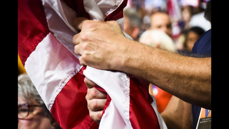 A delegate grips an American flag at the Democratic National Convention on June 28.