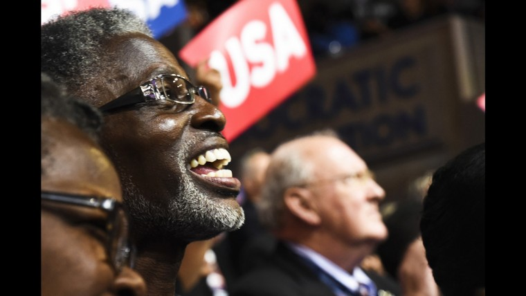 A South Carolina delegate listens to a speech by Reverend William Barbe at the Democratic National Convention on June 28.
