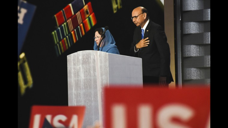 Khizr Khan, father of Captain Humayun Khan who was killed in the Iraq War while serving in the U.S. Army, addresses the crowd at the Democratic National Convention on June 28. His wife, Ghazala Khan, looks on.