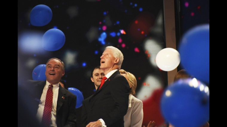 Vice Presidential pick Tim Kaine and president Bill Clinton marvel at falling balloons at the closing of the DNC on June 28.