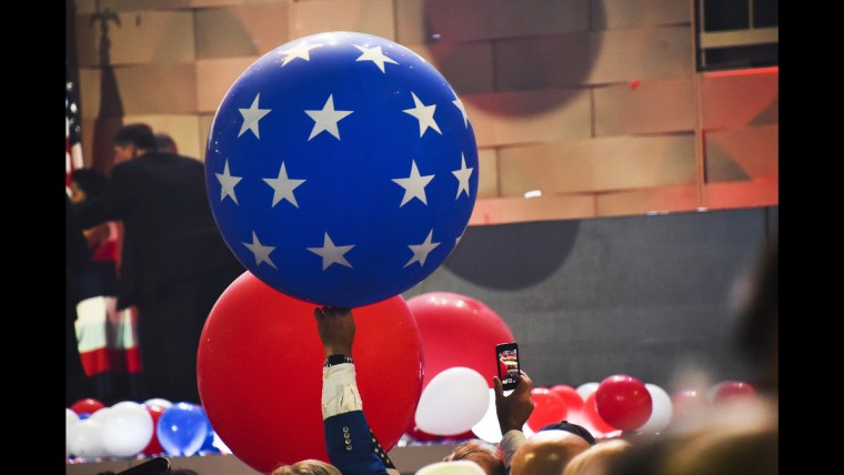 A delegate hoists a balloon following Hillary Clinton's acceptence speech at the Democratic National Convention on July 28.