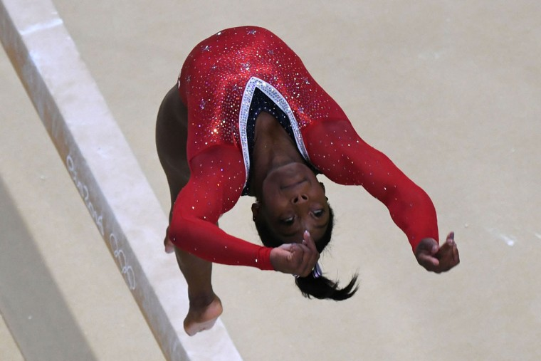 An overview shows US gymnast Simone Biles competing in the women's balance beam event final of the Artistic Gymnastics at the Olympic Arena during the Rio 2016 Olympic Games in Rio de Janeiro on August 15, 2016. (TOSHIFUMI KITAMURA/AFP/Getty Images)