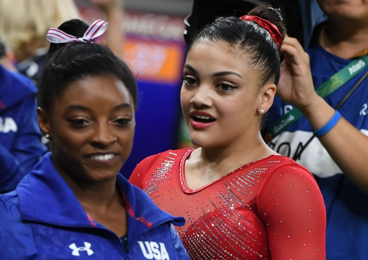US gymnast Lauren Hernandez (right) is congratulated by US gymnast Simone Biles during the women's balance beam event final of the Artistic Gymnastics at the Olympic Arena during the Rio 2016 Olympic Games in Rio de Janeiro on August 15, 2016. (TOSHIFUMI KITAMURA/AFP/Getty Images)