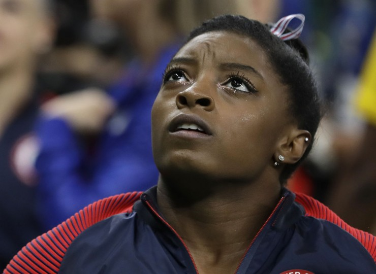 United States' Simone Biles looks at the scoreboard for the final results for the balance beam during the artistic gymnastics women's apparatus final at the 2016 Summer Olympics in Rio de Janeiro, Brazil, Monday, Aug. 15, 2016. (AP Photo/Rebecca Blackwell)