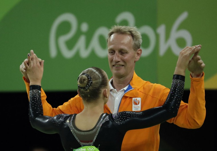 Netherlands' Sanne Wevers celebrates with her coach after winning gold on the balance beam during the artistic gymnastics women's apparatus final at the 2016 Summer Olympics in Rio de Janeiro, Brazil, Monday, Aug. 15, 2016. (AP Photo/Dmitri Lovetsky)