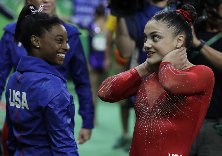 United States' Simone Biles congratulates compatriot United States' Lauren Hernandez for her balance beam performance during the artistic gymnastics women's apparatus final at the 2016 Summer Olympics in Rio de Janeiro, Brazil, Monday, Aug. 15, 2016. (AP Photo/Rebecca Blackwell)