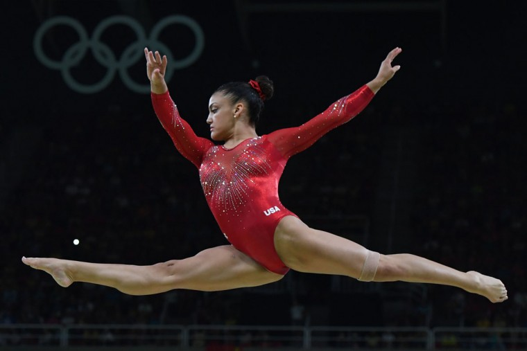 US gymnast Lauren Hernandez competes in the women's balance beam event final of the Artistic Gymnastics at the Olympic Arena during the Rio 2016 Olympic Games in Rio de Janeiro on August 15, 2016. (TOSHIFUMI KITAMURA/AFP/Getty Images)