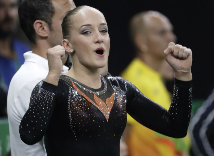 Netherlands' Sanne Wevers celebrates after her performance on the balance beam during the artistic gymnastics women's apparatus final at the 2016 Summer Olympics in Rio de Janeiro, Brazil, Monday, Aug. 15, 2016. (AP Photo/Julio Cortez)