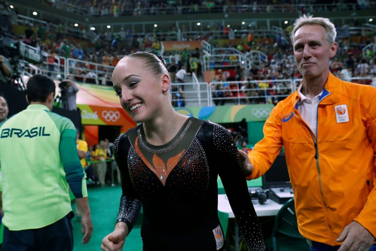 Netherlands' Sanne Wevers celebrates after winning the women's balance beam event final of the Artistic Gymnastics at the Olympic Arena during the Rio 2016 Olympic Games in Rio de Janeiro on August 15, 2016. (THOMAS COEX/AFP/Getty Images)