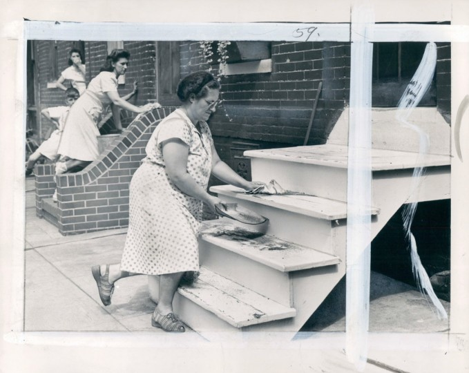 Elizabeth Jakubowski and Mary Demski wash steps on Reynolds street, 1949. (Merriken/Baltimore Sun)